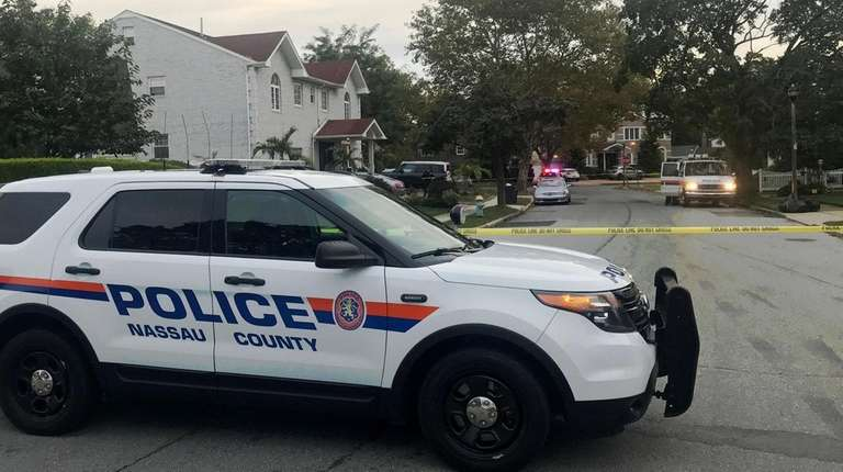 Nassau County police respond to an Elmont neighborhood