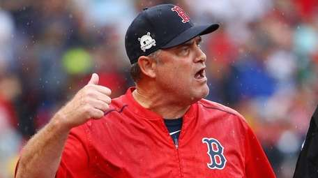 Red Sox manager John Farrell argues a call
