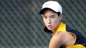 Commack's Emily Tannenbaum hits the backhand return against Harborfield's