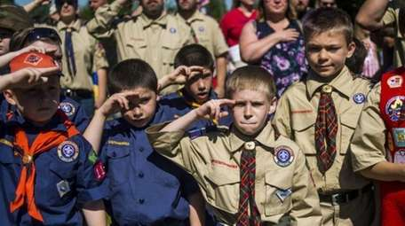 Boy Scouts and Cub Scouts salute during a