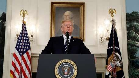 President Donald Trump makes a statement about the