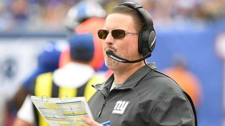 Giants coach Ben McAdoo looks on during the