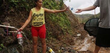In Utuado, Yanira Rios collects spring water on