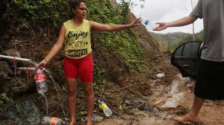 In Utuado, Yanira Rios collects spring water on