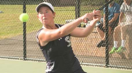 Eastport-South Manor's Jackie Bukzin hits a backhand during