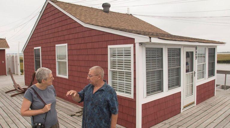 Nancy Solomon, of Port Washington, visits with Al