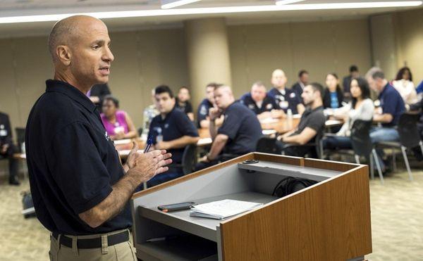 Northwell volunteers listen to team leader Randy Howard