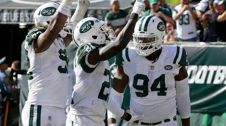 Kony Ealy (94) of the Jets celebrates his