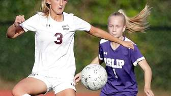 Kings Park's Samantha Hogan (3) controls the pass