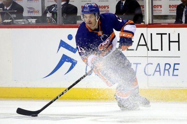 Islanders' Mathew Barzal skates with the puck in