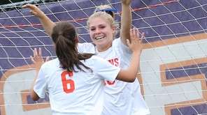 Manhasset's Madison Rielly celebrates a goal with Lauren