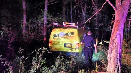 Suffolk County police respond to a crash after