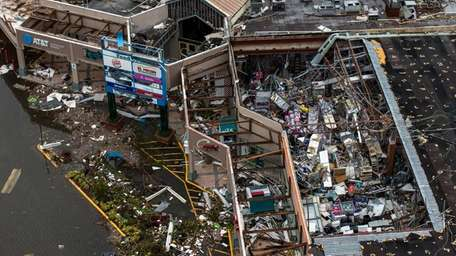 Debris covers the interior of a building with