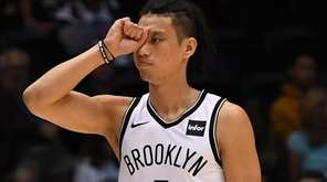 Nets guard Jeremy Lin reacts after he is