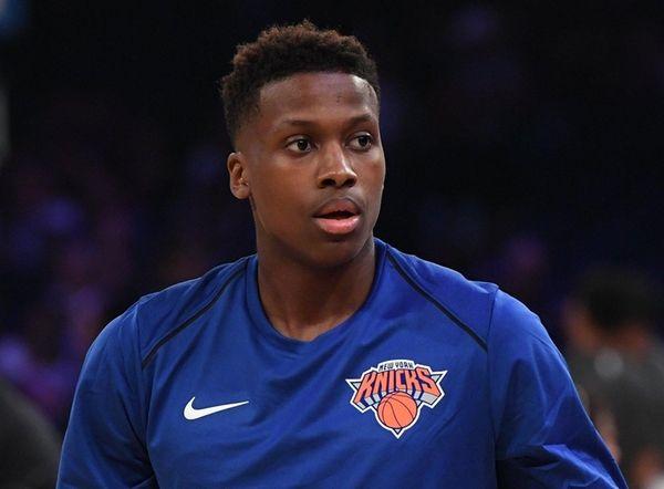 Knicks guard Frank Ntilikina looks on during warmups