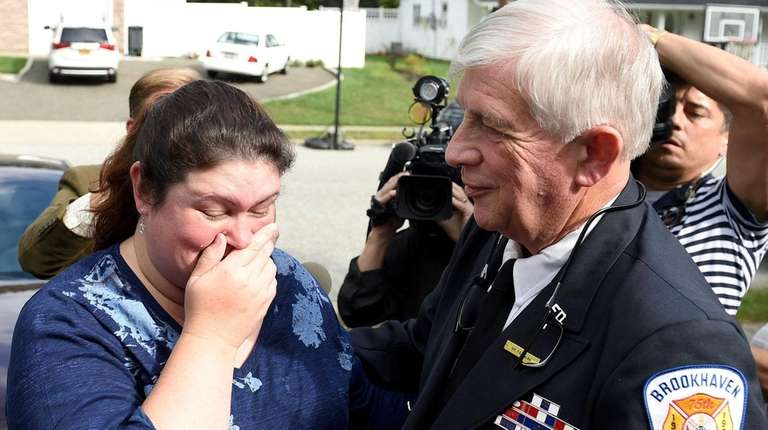 Janice Esposito becomes emotional as she embraces firefighter