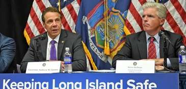 Gov. Andrew M. Cuomo, left, and Suffolk County