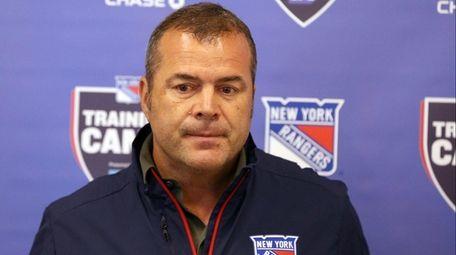 Rangers coach Alain Vigneault talks to media as