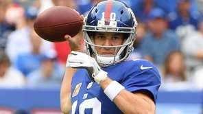 Giants quarterback Eli Manning passes against the Chargers