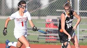 Sachem North's Carolyn O'Brien plays the ball in