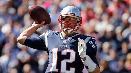 Patriots quarterback Tom Brady throws a pass during