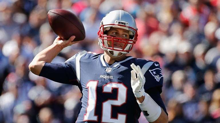 Patriots quarterback Tom Brady throws a pass during