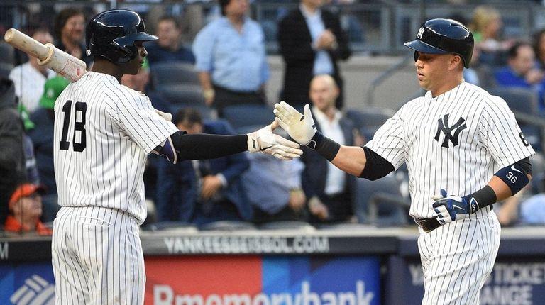 Yankees shortstop Didi Gregorius greets then-Yankees DH Carlos