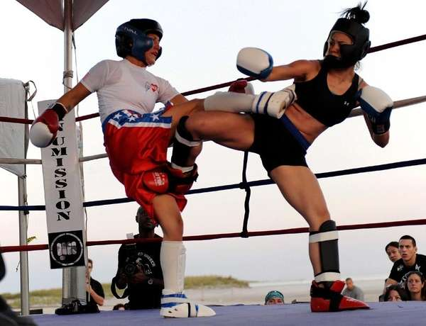 Jennie Nedell, left, and Christy Tyquienqco exchange kicks