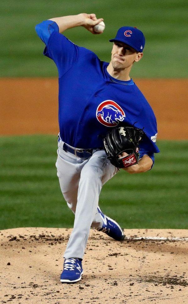 Cubs starting pitcher Kyle Hendricks throws during
