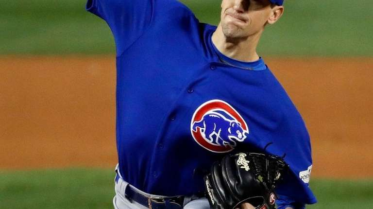 Cubs starting pitcher Kyle Hendricks throws during