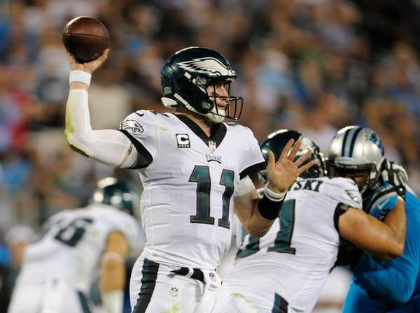 Eagles quarterbackCarson Wentz looks to pass against thePanthers