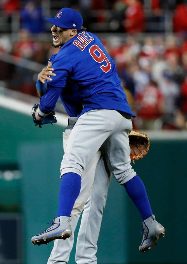 Cubs'Javier Baez hugs Addison Russell after beating the