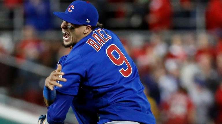 Cubs' Javier Baez hugs Addison Russell after beating the