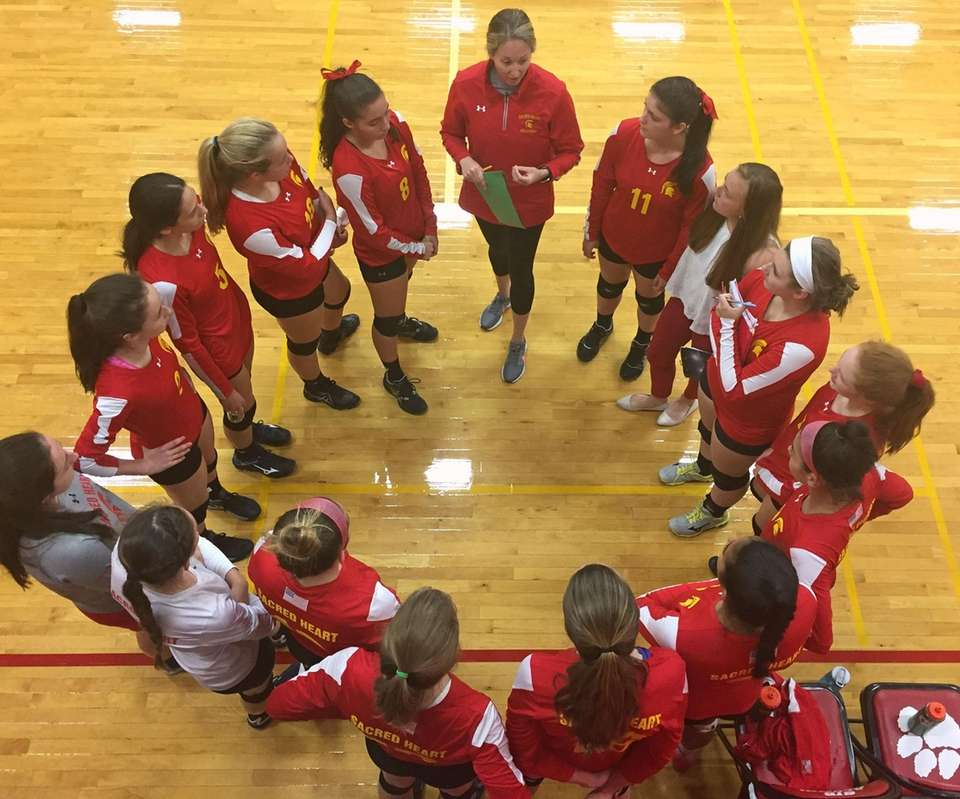 Sacred Heart Academy players listen to Coach Emily