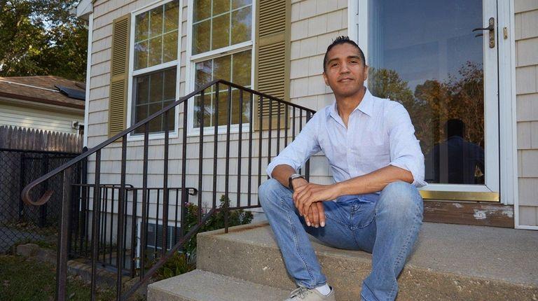 Sean Rubinstein sits near his new home in