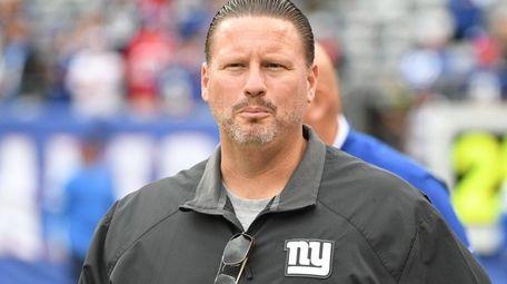 Giants head coach Ben McAdoo walks onto the