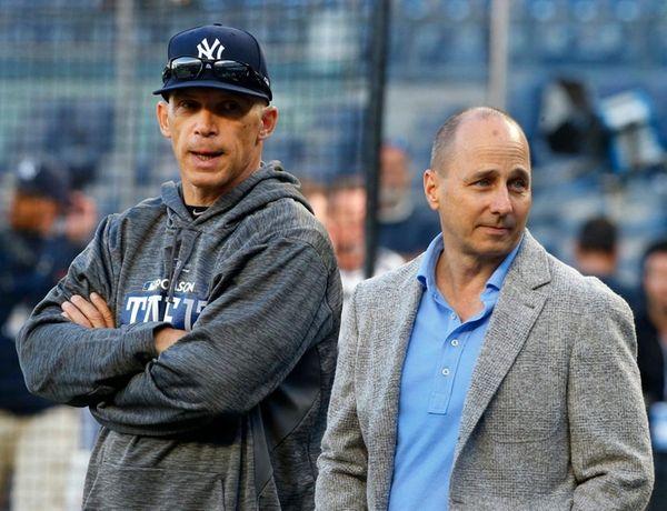 Yankees manager Joe Girardi (left) and general manager