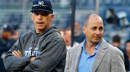 Yankees manager Joe Girardi (left) and general manager