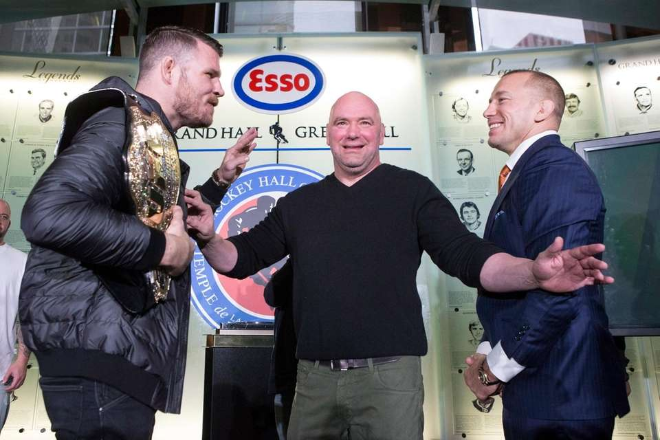 UFC President Dana White separates Michael Bisping, left,