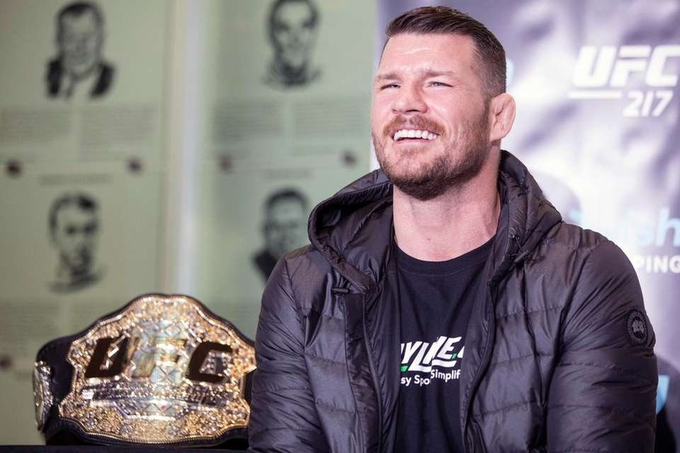 Michael Bisping smiles during a news conference to