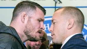 Michael Bisping, left, and Georges St-Pierre face off