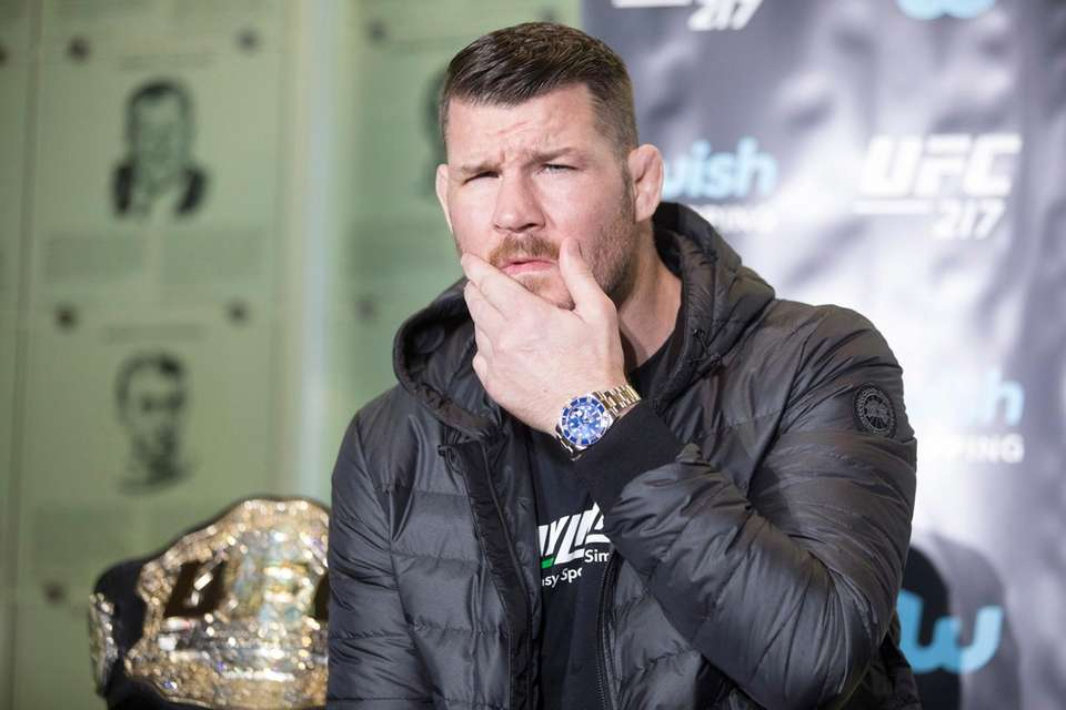 Michael Bisping gestures during a news conference to
