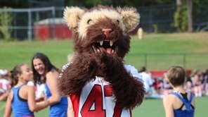 The Newfield High School Wolverine cheers at the