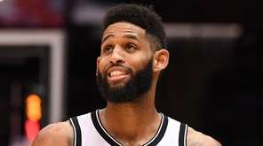 Nets guard Allen Crabbe looks on against the