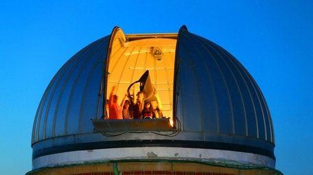 Visitors looking up at the skies at an