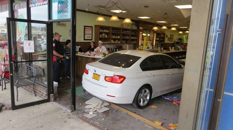 A white BMW sedan smashed through the glass