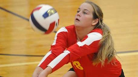 Riley Leimbach of Sacred Heart makes a dig