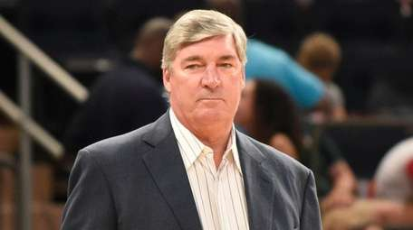 Bill Laimbeer reacts to a play during a