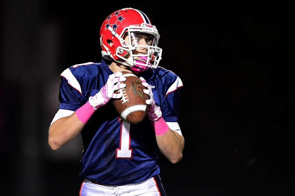 Kyle Acquavella of MacArthur looks to pass against