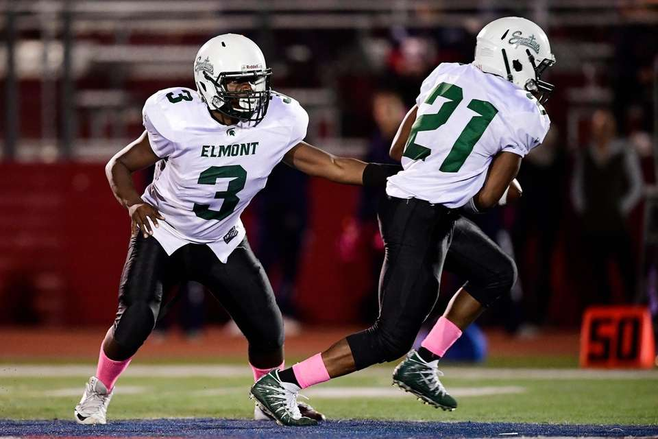 Michael Djalo of Elmont takes the handoff from